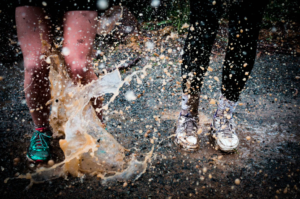 runners in mud