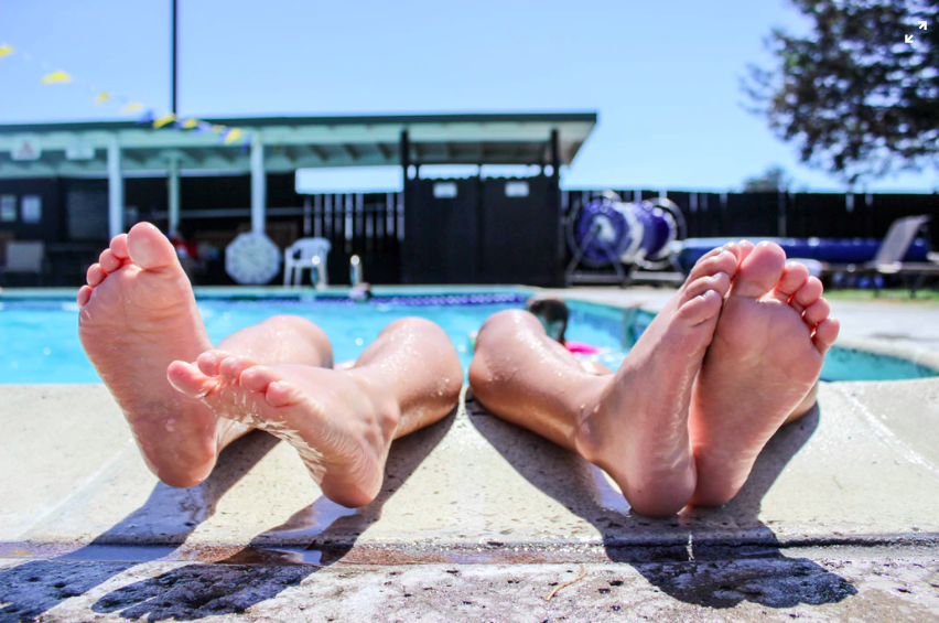 feet on poolside