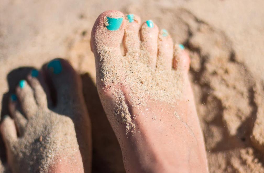 sand on feet